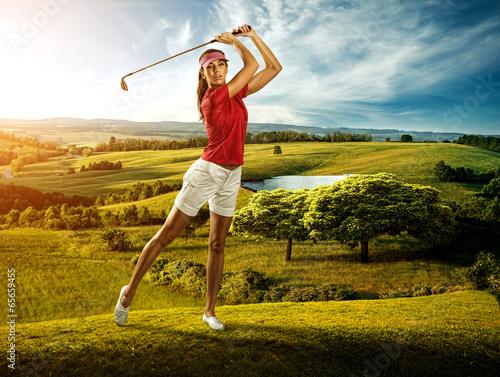 Woman golfer hitting the ball on the  scenery  beautiful - 65659455