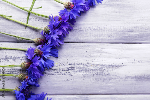 Beautiful cornflowers on wooden background