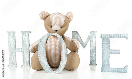 Decorative letters forming word HOME with teddy bear isolated
