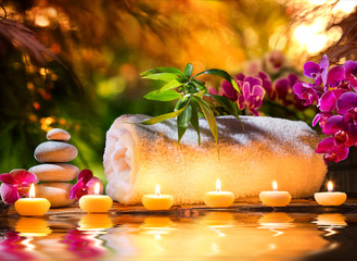 Fototapeta masaż spa w ogrodzie - świece i woda