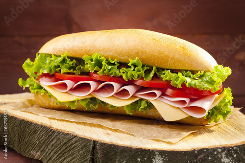 Staande foto Snack big sandwich with ham, cheese and vegetables