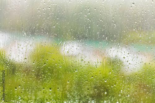 Naklejka na szybę raindrops on windowpane in summer day
