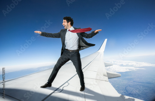 Businessman riding an airplane Canvas Print