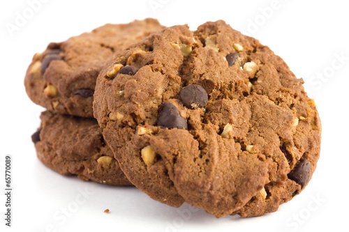Tuinposter Koekjes Chocolate chip and nut biscuits with crumbs on white