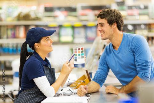 Fotografie, Obraz  paint store assistant helping customer choose paint color