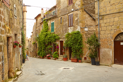 Vintage street decorated with flowers, Tuscany, Italy