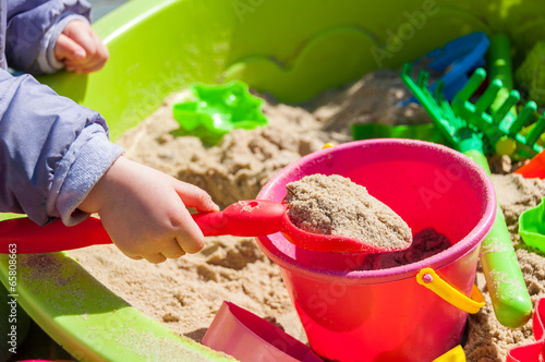 Child playing in sandbox Canvas Print