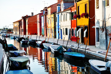 Fototapeta na wymiar Venice, Burano island, boats on canal and colorful houses, Italy