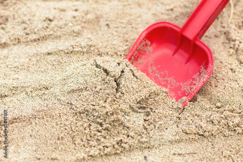 Children's shovel in the sandbox. Canvas Print