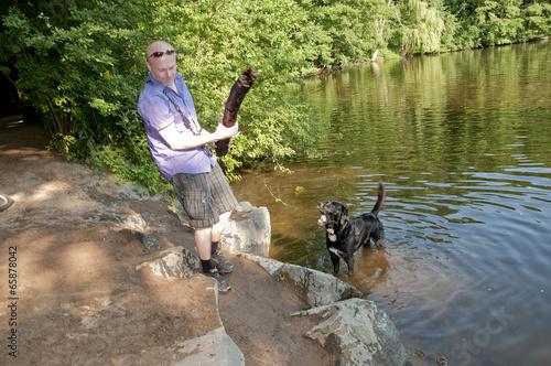 Foto op Aluminium Ijsbeer Man with dog at lake