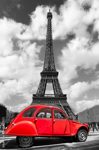 Obraz Eiffel Tower with red old car in Paris, France - fototapety do salonu