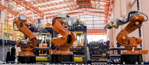 Fotografie, Obraz  Robots welding in a production line