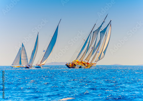 Tuinposter Zeilen several classic wooden sailing boats in Spetses island in Greece