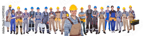Fotografia  Construction Worker With Colleagues Over White Background