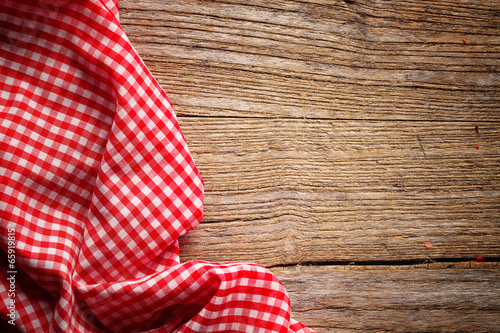 Fotografie, Obraz  Checkered tablecloth on wooden table