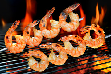 FototapetaGrilled shrimps on the flaming grill