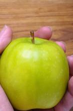 Hand Holding Green Apple