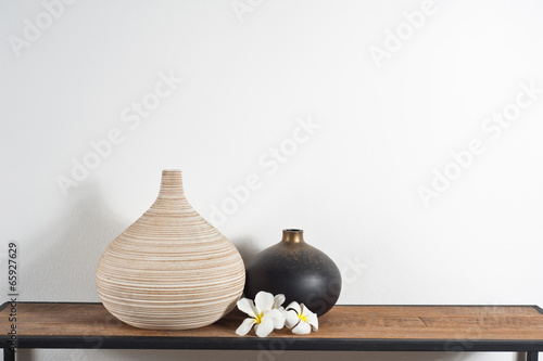 Fotografia, Obraz  Vases decorated with Frangipani flower