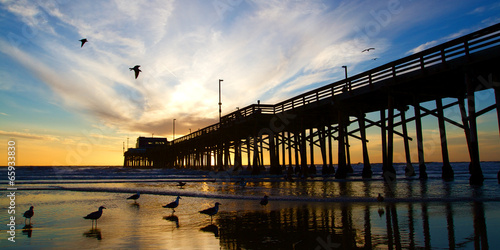 Photo  Newport Beach California Pier at Sunset in the Golden Silhouette