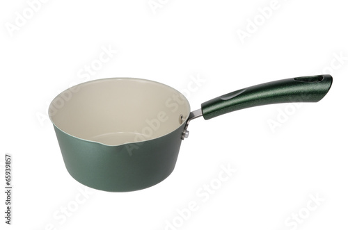 Green metal pot with a long handle. Isolated on white Canvas Print