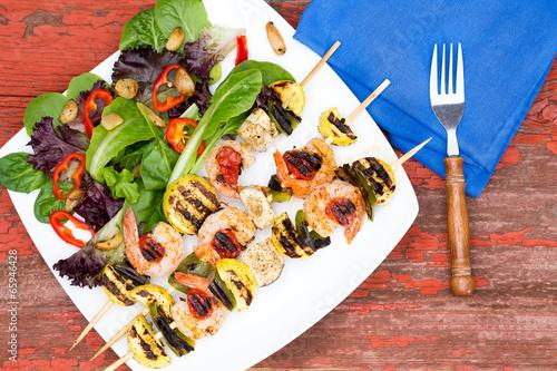 Fotografie, Obraz  Gourmet shrimp skewers with salad greens
