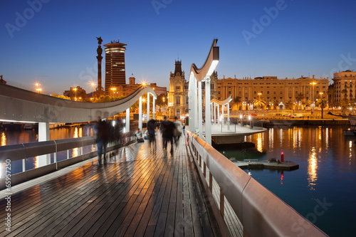 Papiers peints Barcelona Rambla del Mar over Port Vell in Barcelona at Night