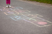 Girl Playing Hop-scotch Outside