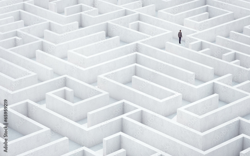 Fototapeta Businessman looking for way out of a maze