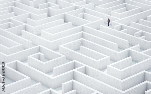 Fotografía Businessman looking for way out of a maze
