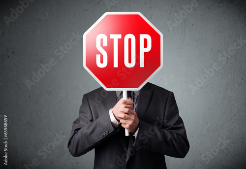 Fotografie, Obraz  Businessman holding a stop sign