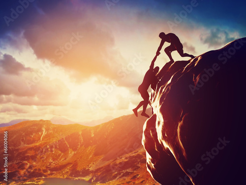 Fotografie, Obraz  Hikers climbing on mountain. Help, risk, support, assistance
