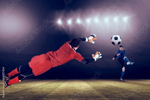 Fototapety, obrazy: Composite image of fit goal keeper jumping up