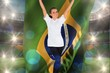 Composite image of excited football fan in white cheering holdin