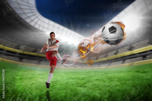 Fototapety, obrazy: Composite image of football player in white kicking