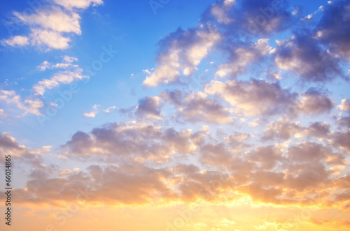 Foto op Plexiglas Landschappen Yellow blue sunset sky with sunlight