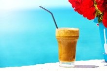 Ice Coffee Against Sea Background.