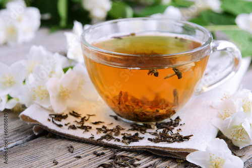 Cup of tea with jasmine on table close-up - 66086849