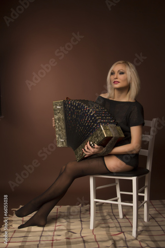 Valokuva  young woman with with an accordion