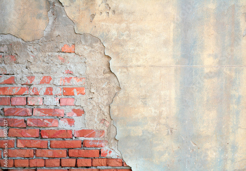 Foto op Canvas Baksteen muur Half painted brick wall
