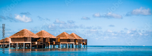 Fototapeta Over water bungalows with steps