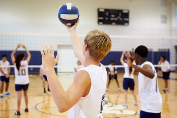 Fototapeta High School Volleyball Match In Gymnasium