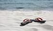 Flip flop on white sand