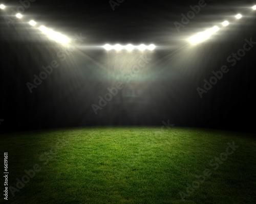 Football pitch under bright spotlights Wallpaper Mural