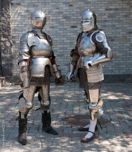 two knights in the ancient metal armor Wallpaper Mural