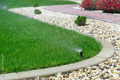 Photo Stands Green Sprinklers watering grass