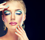 Trendy make-up and manicure ,a model with a bright makeup