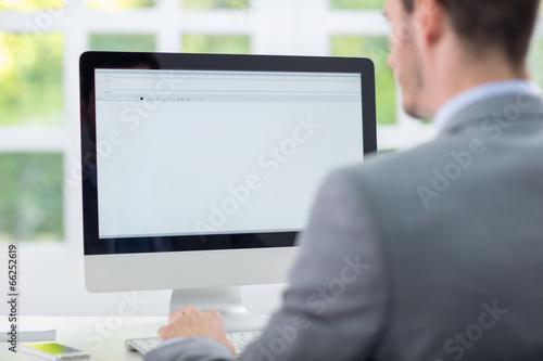 Fotografie, Obraz  Obchodník pracující na počítači