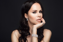 Portrait Of Beautiful Woman With Long Hair And Jewelry
