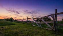 Blue-colored Twilight, Old Wooden Fence In The Foreground