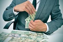 Man In Suit Getting Dollar Bil...